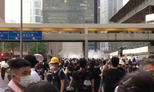 Police fire tear gas from above as protesters gather in Hong Kong