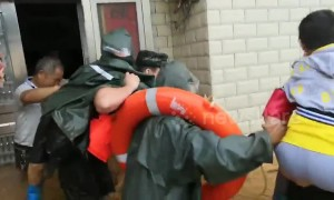 Woman trapped in flooded house cries out after firefighters finally arrive to rescue her