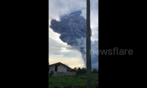 Massive ash cloud billows into air in North Sumatra following volcano's eruption
