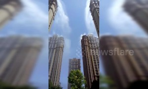 Chinese residential community sprays water from skyscrapers to combat heat wave