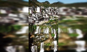 Amazing drone footage showcases China's ancient town built around waterfall