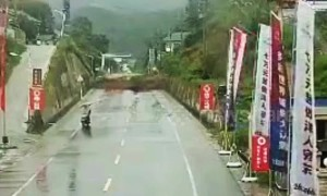 Massive landslide in China blocks highway seconds after motorcyclist drives past
