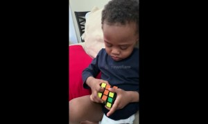 Genius three-year-old boy solves his first Rubik's Cube