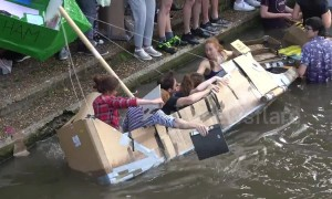 Students at UK's elite Cambridge University celebrate end of exams with annual alcohol-fuelled cardboard boat race
