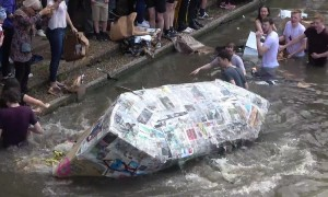 Boozed-up Cambridge University students celebrate end of exams with annual cardboard boat race