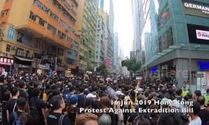 Hong Kong protesters in black shirts shout 'Carrie Lam resign' at third massive demonstration