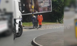 Heartwarming moment as truck driver stops to help little old lady cross road