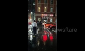 Man attempts to 'fight' rain while standing in the middle of a road in Sydney