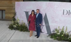 Former British PM David Cameron arrives with wife Samantha at the V and A Museum Summer Party