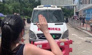 Hong Kong protesters block police van