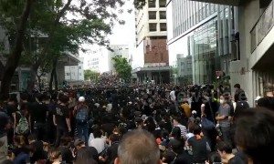 Sea of protesters block roads outside Hong Kong police headquarters