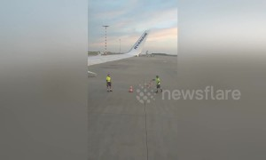 Ryanair workers caught on camera playing 'cone flip' game on runway at Prague airport