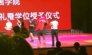 Excited graduate in China falls over on stage with university president in his arms