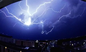 Slow Motion Lightning Strike Streaks Across Sky