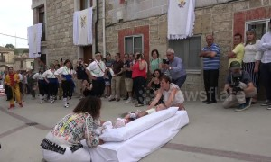 Men jump over babies and whip locals in bizarre yet entertaining Spanish festival