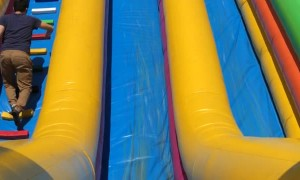 Daughter on Slide Takes a Dive
