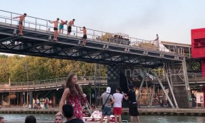 Parisians dive into canal to stay cool during heatwave