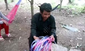 Cambodian father who couldn't afford to buy new rucksack for his son weaves one by hand from blue string