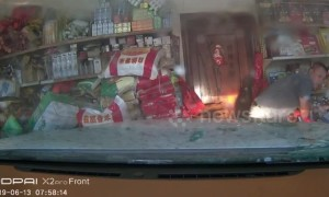 Inexperienced driver crashes into shop after avoiding motorcycle in China