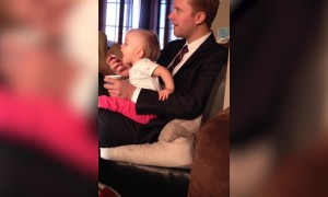 Baby is too Hungry to Wait for Dad to Bring the Spoon to Her
