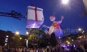 Giant puppet walks down road in East London
