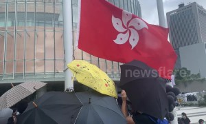 Hong Kong protesters raise black flag in front of Legislative Council