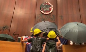 Hong Kong protesters take over legislative chamber