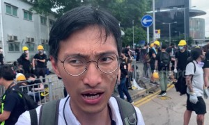 Pro-democracy Hong Kong lawmaker Eddie Chu Hoi Dick demands probe into police behaviour