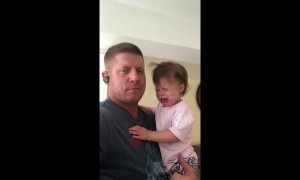 US father has amazing technique to trick daughter into not crying