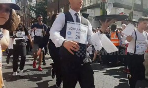 Waiters in London's Soho compete in traditional champagne street race