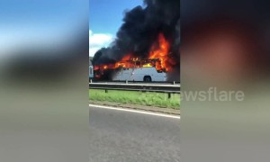 Black smoke pours out of coach that was carrying UK children