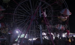 Terrifying scenes as Indonesian fairground goers become stranded on ferris wheel