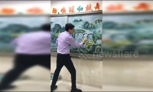 Chinese art teacher draws incredible landscapes on blackboard with chalk