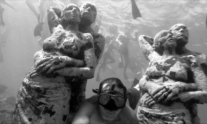 Crowds Swim to Underwater Statues