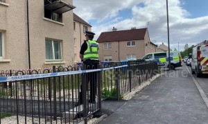 Man and dog killed in Scotland flat fire