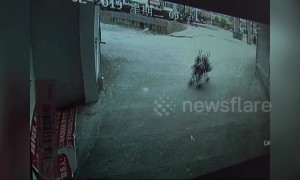 Heroic man stops baby in pushchair from slamming into concrete wall in China