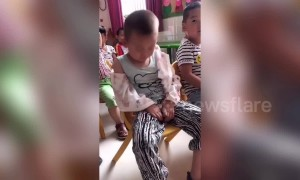 Nursery teacher pranks boy nodding off during class in China's Zhoukou
