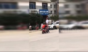 Six people ride on one scooter to test its capacity in China