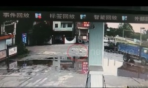 Chinese cyclist escapes serious injury after being run over by truck in China