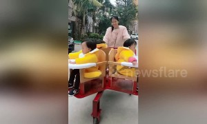 Homemade spinning pushchair designed for triplets spotted in China's Zhuhai