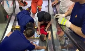 Firefighters free toddler after he got his arm stuck in escalator in Chinese mall
