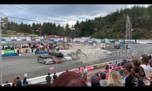 Car stunt man crashes into a high stack of cars