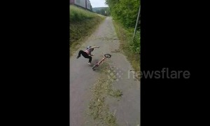 Swedish toddler takes a painful tumble while riding bike down a hill