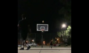 Guy plays 1-on-1 against dog, hits two incredible shots