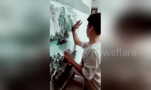 Talented man uses arm and palm to draw incredible landscapes in China