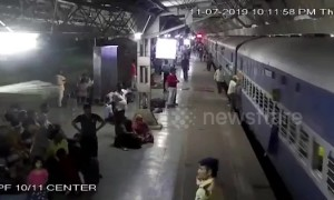 Commuters rush to save woman from being run over by train in western India