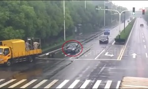 Car slams into utility pole trailing from truck in China's Changshu