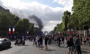 French riot police use tear gas to disperse Bastille Day protesters