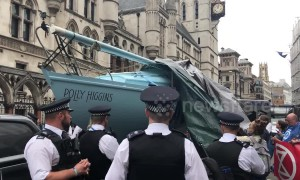 Cheers ring out as blue boat unveiled at London Extinction Rebellion protest