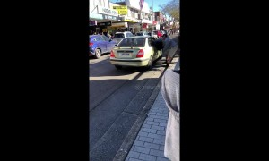 Shocking Sydney road rage results in man nearly being dragged out of car